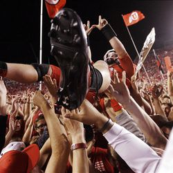 Utah Utes quarterback Jon Hays (9) is lifted and carried by Ute fans after the win over BYU  in Salt Lake City  Sunday, Sept. 16, 2012.