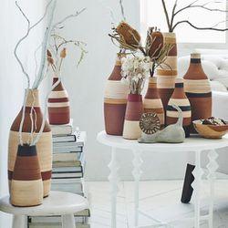 "Stripe Vases, <a href=""http://www.westelm.com/products/steven-alan-stripe-vase-d2073/?pkey=csteven-alan&"">$24-$59</a>"