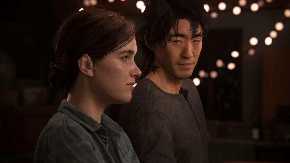 a young woman (Ellie) and young man (Jesse) standing under lights in The Last of Us Part 2