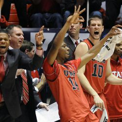 The Utah Utes bench celebrate a 3-point basket by Utah Utes guard Brandon Taylor (11) during a game at the Jon M. Huntsman Center on Saturday, Dec. 14, 2013.