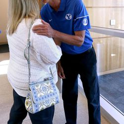 Robbie Bosco gets a hug from Jill Lyon at BYU Football Media Day at BYU Broadcasting in Provo on Friday, June 23, 2017. Bosco's jersey number was retired.