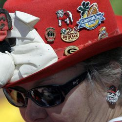 Susan Coffee, of Eastman, Ga., wears a hat in support of Georgia during a University of Georgia Alumni Association tailgate before an NCAA college football game between Georgia and Missouri Saturday, Sept. 8, 2012, in Columbia, Mo. The football game will be the first for Missouri against a Southeastern Conference opponent since joining the conference.