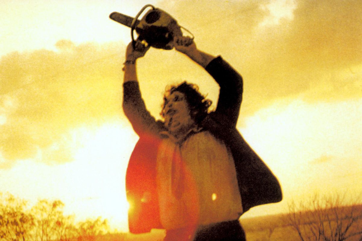 a man wielding a chainsaw