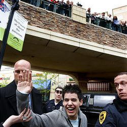 """""""American Idol's"""" David Archuleta is surrounded by security as he waves to fans at The Gateway in Salt Lake City Friday."""