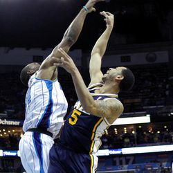 Utah Jazz point guard Devin Harris (5) shoots over New Orleans Hornets power forward Carl Landry (24) in the first half of an NBA basketball game in New Orleans, Friday, April 13, 2012.