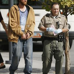 A Salt Lake County sheriff's deputy walks with a man who was arrested as part of Operation Diversion in Salt Lake City on Thursday, Sept. 29, 2016. The operation is a coordinated effort between Salt Lake County, Salt Lake City and drug treatment providers to strategically attack the drug market that has permeated the homeless population spilling out of downtown shelters. Those who were arrested were transported to the Salt Lake County Jail or to a temporary receiving center where medical experts will screen them for possible referral to appropriate behavioral health services.