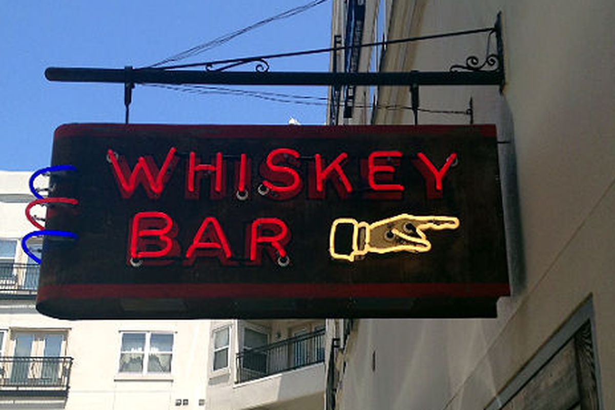 A sign leads the way to the whiskey bar inside Rye 51, a men's clothing store in the West Village.