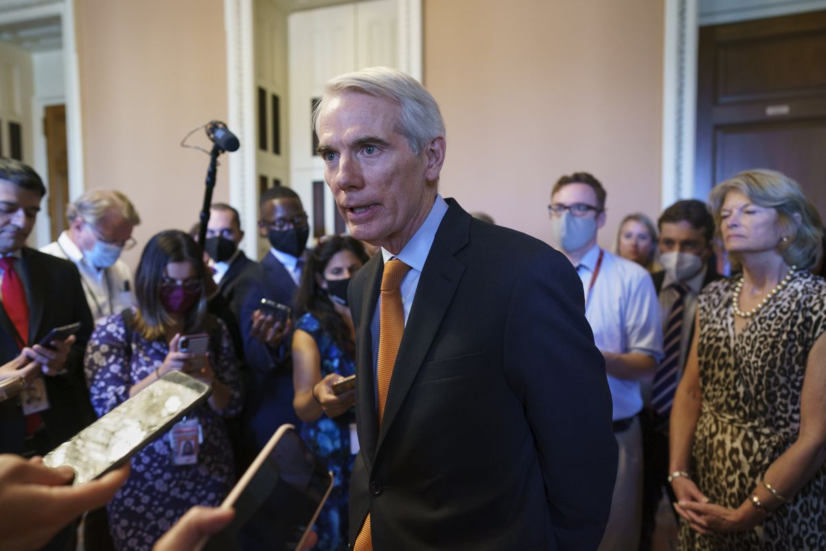 Sen. Rob Portman, R-Ohio, the lead GOP negotiator on the infrastructure talks, talks to reporters as he announces a $1 trillion infrastructure agreement with Democrats and is ready to vote to take up the bill, at the Capitol in Washington, Wednesday, July 28, 2021.