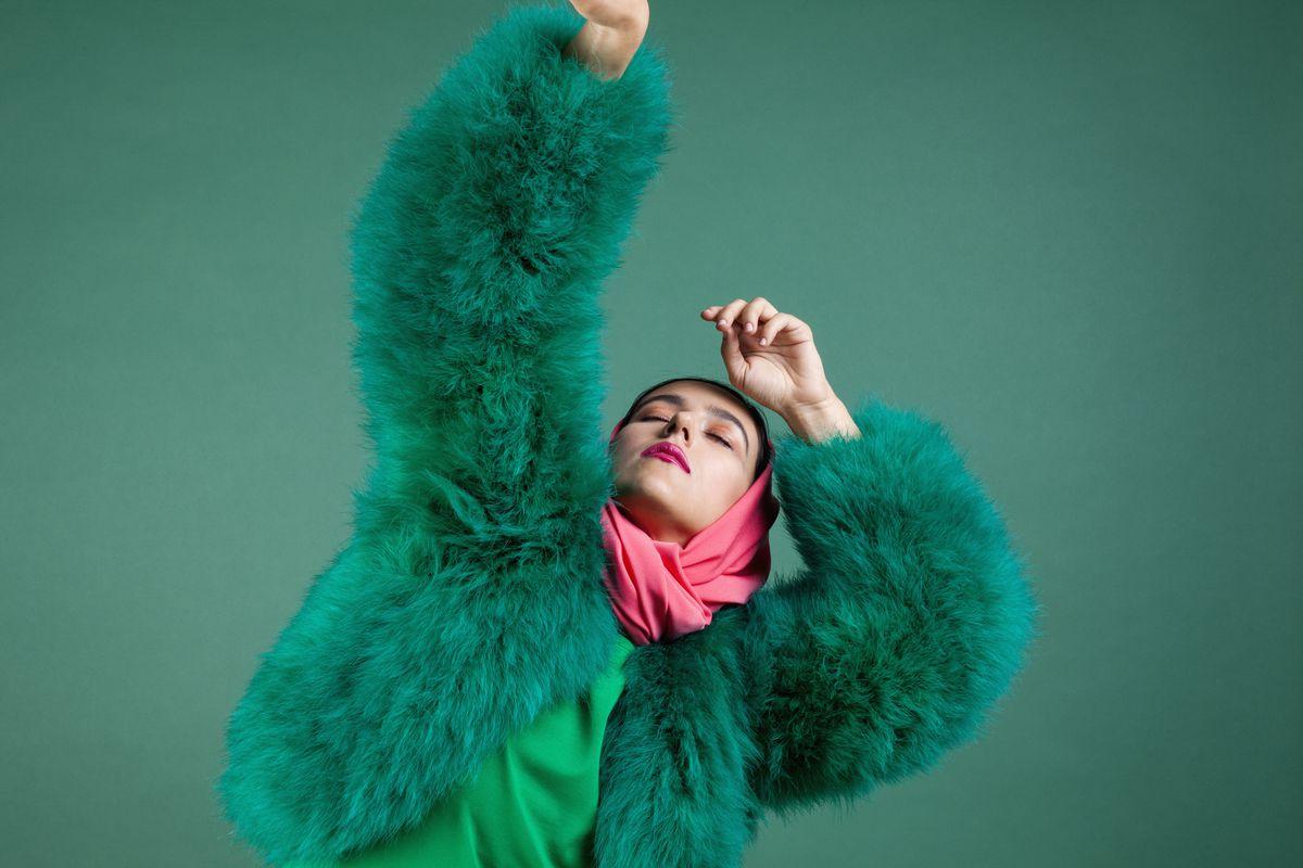 Woman in green fur coat