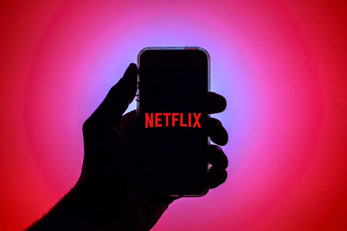 In this photo illustration the Netflix App seen displayed on...
