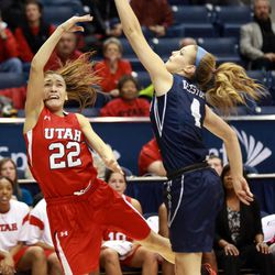 Utah's Danielle Rodriguez passes the ball over BYU's Kim Beeston during a women's basketball game at the Marriott Center in Provo on Saturday, Dec. 14, 2013. Utah won in double overtime 82-74.