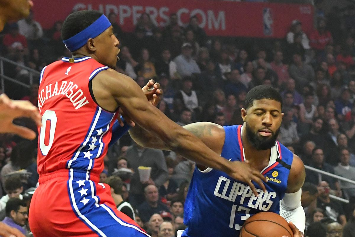Philadelphia 76ers guard Josh Richardson defends Los Angeles Clippers guard Paul George as he drives to the basket in the first quarter of the game at Staples Center.