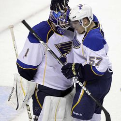St. Louis Blues goalie Brian Elliott (1) and left wing David Perron (57) congratulate each other after their game against the San Jose Sharks in Game 4 of an NHL Stanley Cup first-round hockey playoff series, Thursday, April 19, 2012, in San Jose, Calif. The Blues defeated the Sharks 2-1. They lead the series 3-1.