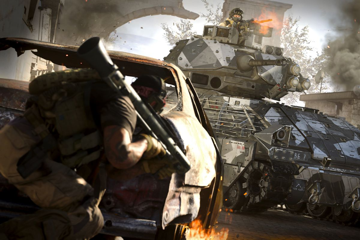 a player with a rocket launcher hides behind a wrecked car while another rides a tank in a screenshot from Call of Duty: Modern Warfare (2019).