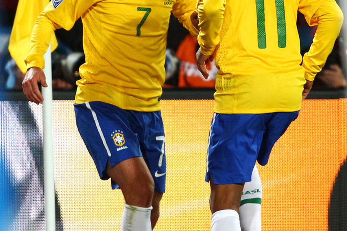 Robinho and Elano celebrate Brazil's second goal in their 2-1 victory over North Korea. (Picture from Getty images)