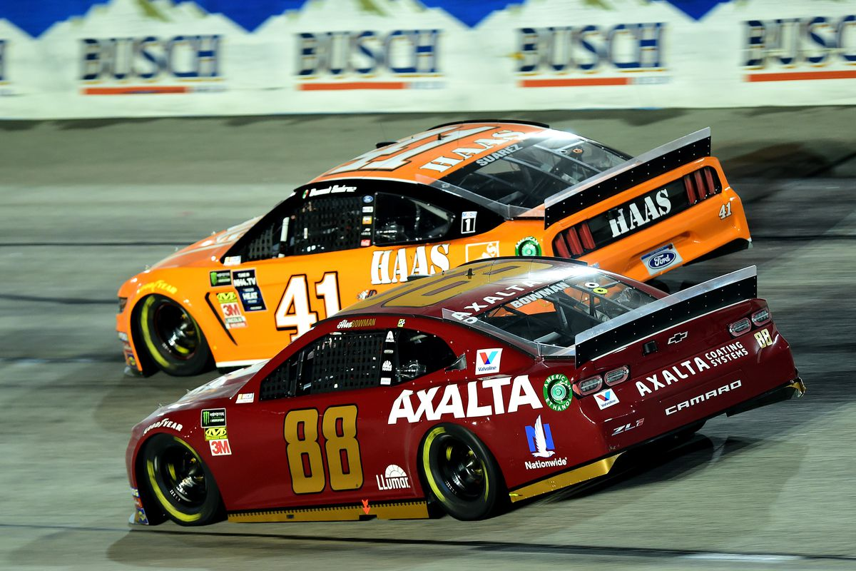Daniel Suarez, driver of the #41 Haas Automation Ford, leads Alex Bowman, driver of the #88 Axalta Throwback Chevrolet, during the Monster Energy NASCAR Cup Series Bojangles' Southern 500 at Darlington Raceway on September 02, 2019 in Darlington, South Carolina.