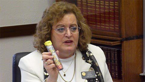 Sen. Evie Hudak shows her EpiPen as a visual aid during a Senate Education Committee debate on Feb. 3, 2011.