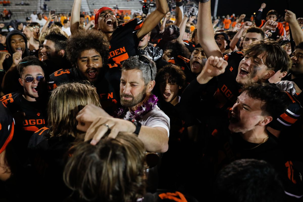 """Ogden football coach Erik Thompson, who was recently diagnosed with Lou Gehrig's disease, celebrates with his team during a high school football game billed as """"Erik Thompson Night"""" on Friday, Sept. 3, 2021, at Ogden High School in Ogden."""