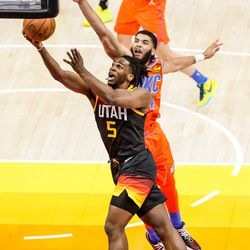 Utah Jazz forward Jarrell Brantley (5) goes to the hoop ahead of Oklahoma City Thunder forward Kenrich Williams (34) during the game at Vivint Smart Home Arena in Salt Lake City on Tuesday, April 13, 2021.