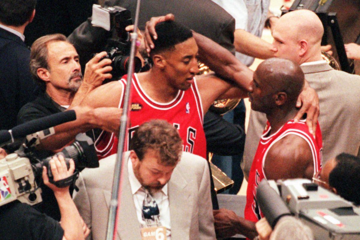 The Bulls' Scottie Pippen, left, and Michael Jordan embrace after winning the 1998 NBA Finals.
