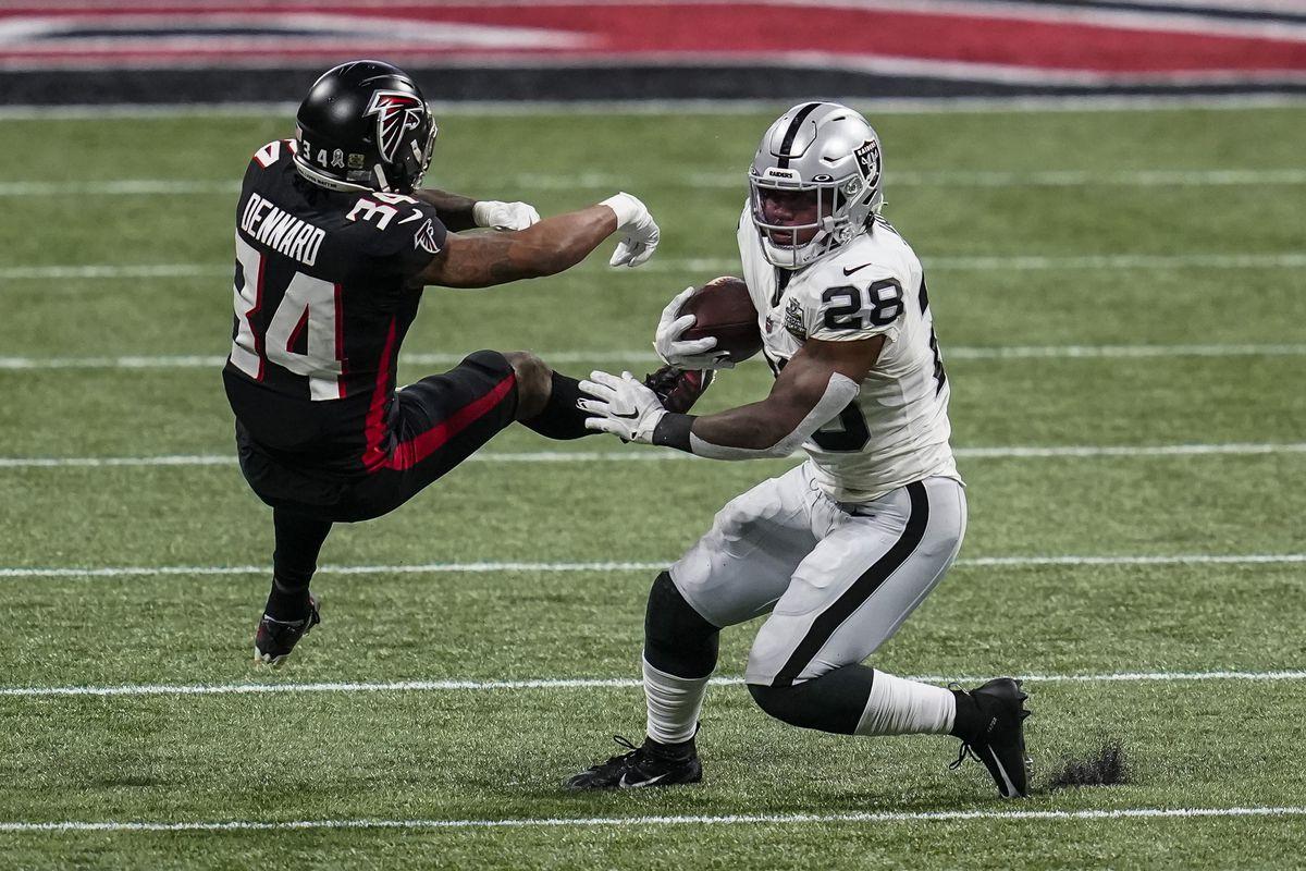 Las Vegas Raiders running back Josh Jacobs (28) avoids a tackle by Atlanta Falcons cornerback Darqueze Dennard (34) during the first quarter at Mercedes-Benz Stadium.