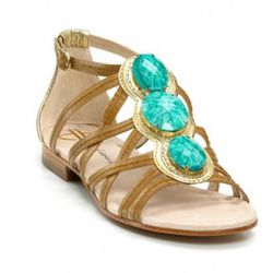 "<i><a href=""http://www1.bloomingdales.com/catalog/product/index.ognc?ID=518437&PseudoCat=se-xx-xx-xx.esn_results"" rel=""nofollow"">Silver Ornamented Flat Sandals</a></i>, $225<br /><br />"