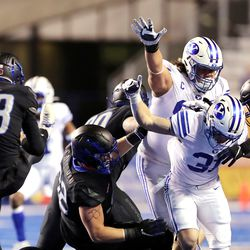 BYU players block a punt by Boise State Broncos place kicker Gavin Wale (43) as they play a college football game at Albertsons Stadium in Boise on Friday, Nov. 6, 2020.