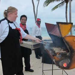 Chef Lisa Sellers working her coconut and secret-garden-grown-herbs marinated skirt steak