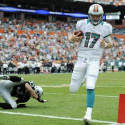 Miami Dolphins quarterback Ryan Tannehill (17) scores a touchdown during the first half of an NFL football game against the Oakland Raiders, Sunday, Sept. 16, 2012, in Miami.