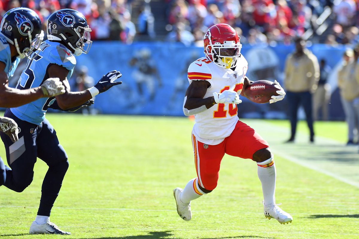 Kansas City Chiefs wide receiver Tyreek Hill runs after a catch against the Tennessee Titans during the first half at Nissan Stadium.