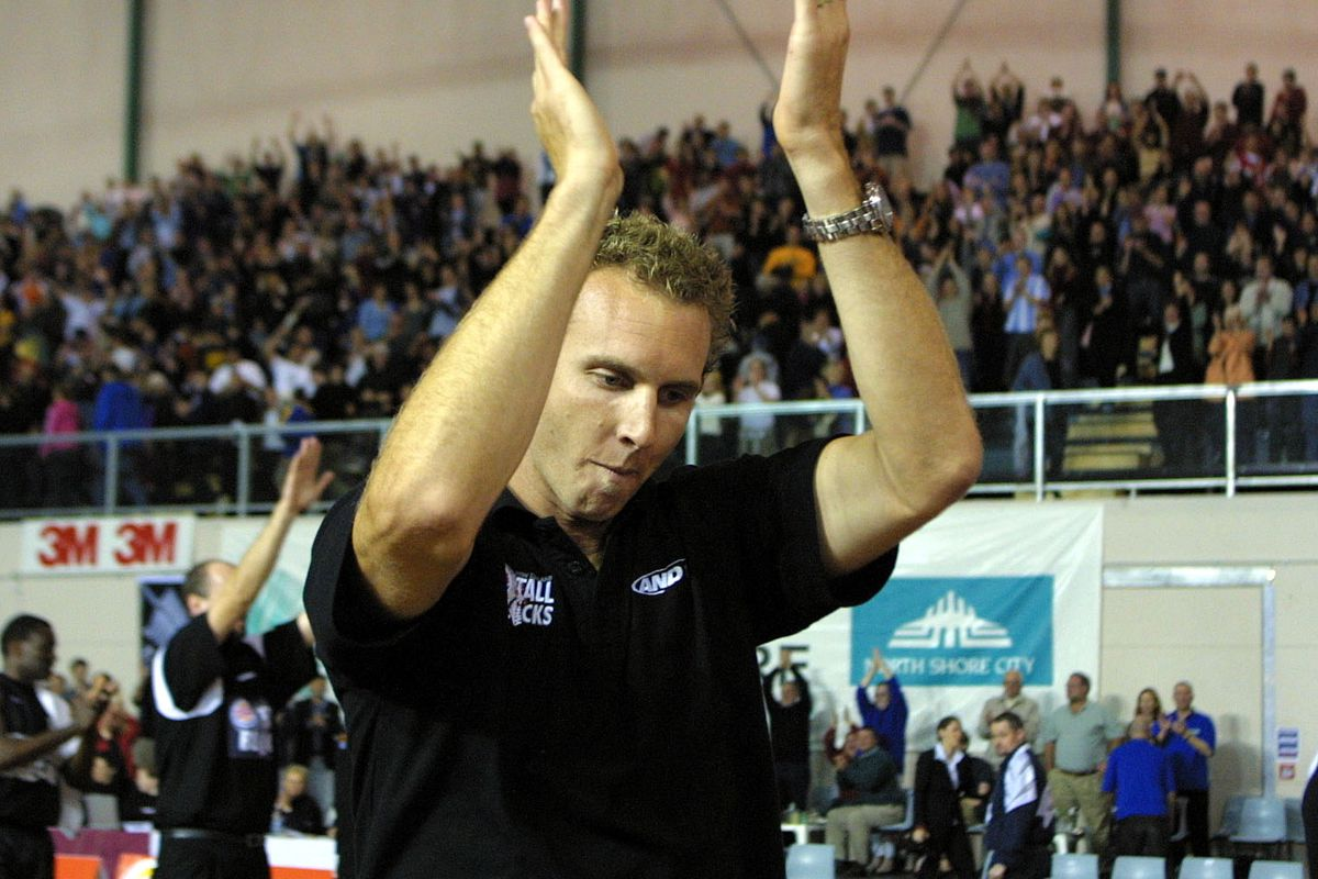 Tall Black Sean Marks thanks the crowd as he leave