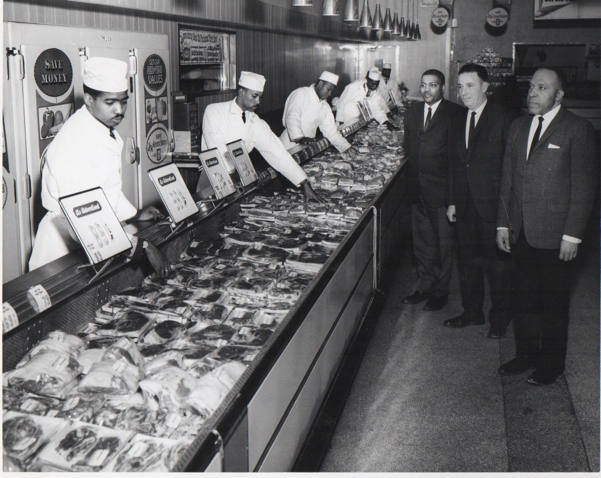 Robert H. Vaughn, (first man in dark suit on left, with mustache) who rose to be an international vice president of the United Food and Commercial Workers, during a visit with union meat-cutters. | Provided photo