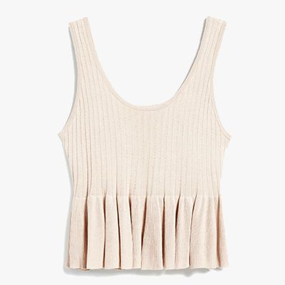 Peach colored frilled knit tank.