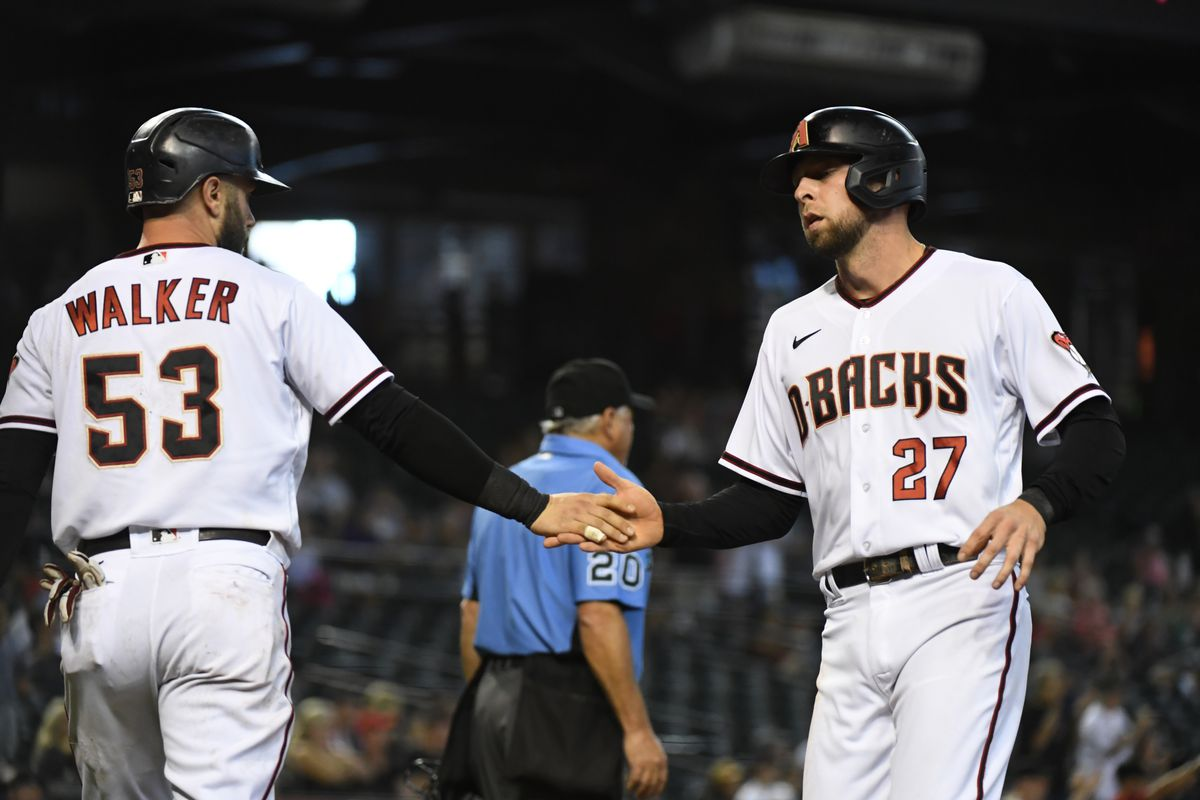 Drew Ellis  and Christian Walker of the Arizona Diamondbacks celebrate with a low #slapHands after scoring on a double by Nick Ahmed against the Philadelphia Phillies
