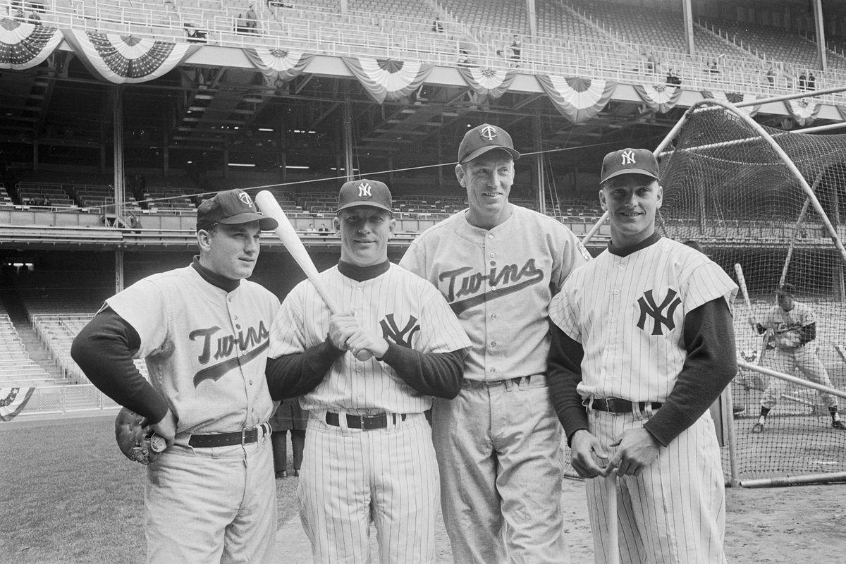 Opposing Baseball Players Posing Together