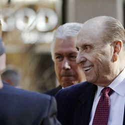 President Thomas S. Monson of The Church of Jesus Christ of Latter-day Saints greets people following a ceremony to open City Creek Center in Salt Lake City, Thursday, March 22, 2012. At left is his second counselor Dieter F. Uchtdorf and at right is first counselor Henry B. Eyring.