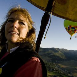 """Anneliese Gengel of Fort Collins, Colo., watches other balloons from the air on Friday during the 15th annual Ogden Valley Balloon Festival in Eden, which runs through Sunday. Each evening at the festival field there will be a live concert with BBQ dinner offered for purchase. The popular """"Balloon Glow"""" will take place Saturday evening at dusk"""