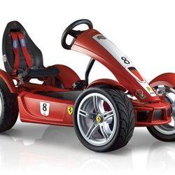 "FXX racers exclusive pedal go-kart, <a href=""http://store.ferrari.com/en/sports-games/games/ride-on-cars/ferrari-fxx-racers-exclusive-pedal-go-kart.html"">$2,300</a>"