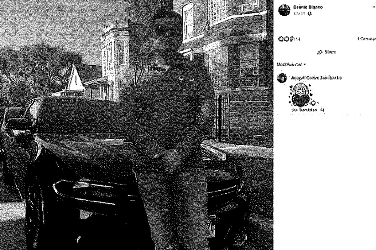 Benjamin Cortez-Gomez poses in front of a Dodge Charger he drove to Indianapolis to buy seven illegal guns for an informant in Chicago, according to federal authorities.