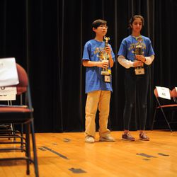 Aaron Chang (left) from the Audubon Elementary School and Maya Joshi from the Young Magnet High School on the stage during award ceremony of the annual Citywide Spelling Bee Championship at the Lindblom Math and Science Academy on March 14, 2019. Aaron Chang, winner of the contest, will represent Chicago Public Schools at the Scripps National Spelling Bee in Washington, D.C., where he will compete against the best spellers from across the nation for the title of 2019 national Spelling Bee Champion and an opportunity to win a $40,000 prize. | Victor Hilitski/For the Sun-Times