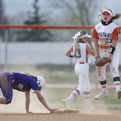 Murray's Ellie Christensen (23) jumps in the air while celebrating her double play after getting Riverton's Kyli Carrell (10) out during a high school girls softball game at Riverview Junior High in Murray on Wednesday, April 7, 2021.