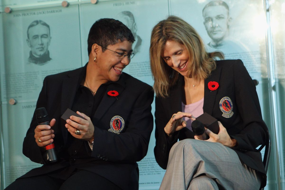 (L-R) Angela James and Cammi Granato share a moment looking at their new Hall rings at the media opportunity prior to their induction ceremony at the Hockey Hall of Fame on November 8, 2010 in Toronto, Canada.
