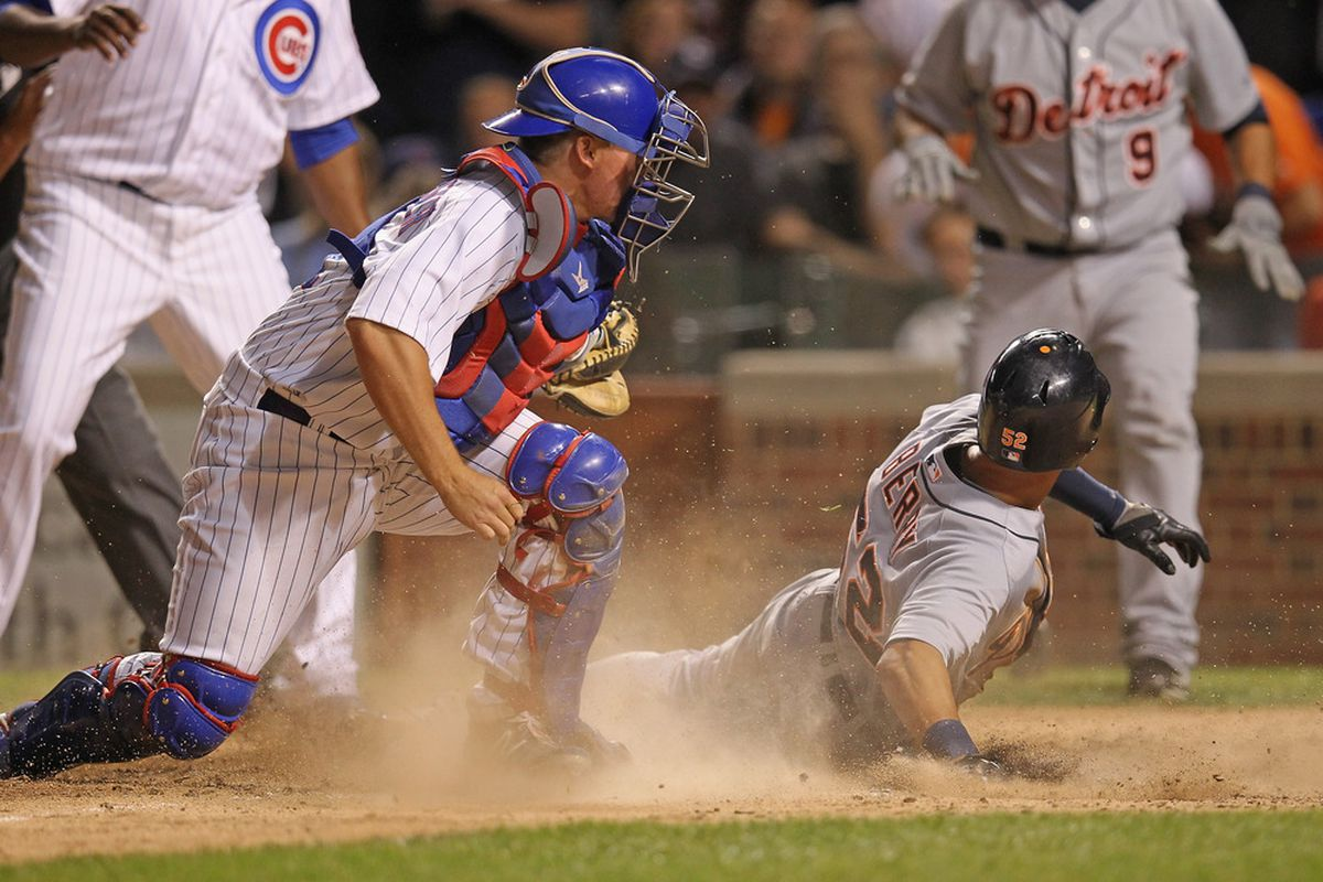 CHICAGO, IL - JUNE 13: Steve Clevenger #51 of the Chicago Cubs tags out Quintin Berry #52 of the Detroit Tigers to end the 8th inning at Wrigley Field on June 13, 2012 in Chicago, Illinois. (Photo by Jonathan Daniel/Getty Images)