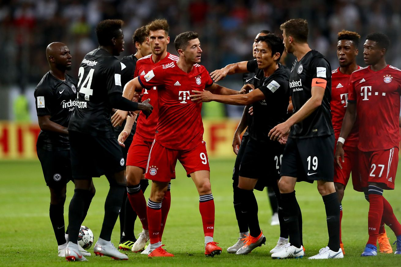 Robert Lewandowski and David Abraham have to be separated after DFL Supercup