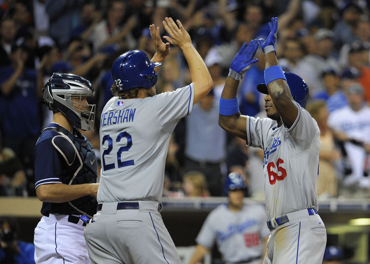 Dodgers pitcher Clayton Kershaw high-fives Puig in 2013