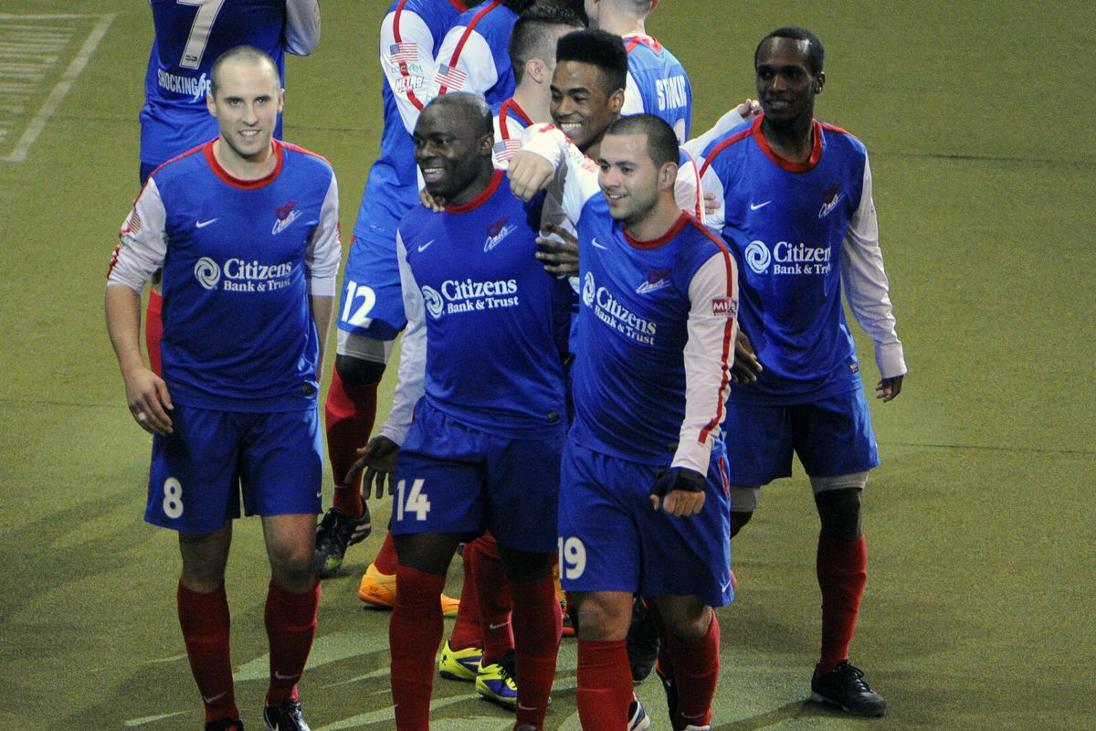 Comets players celebrate after a Leo Gibson score in MISL Championship