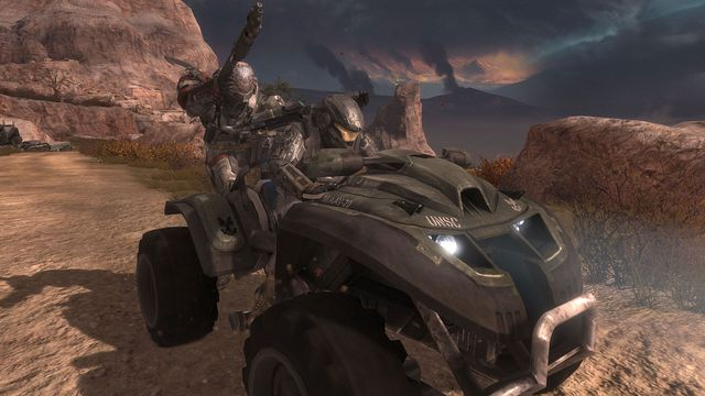 Two characters in Halo Reach riding on a vehicle