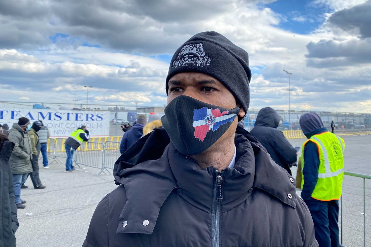 Hunts Point Market worker Manuel Soriano takes part in a strike outside the Bronx food distribution center, Jan. 19, 2021.