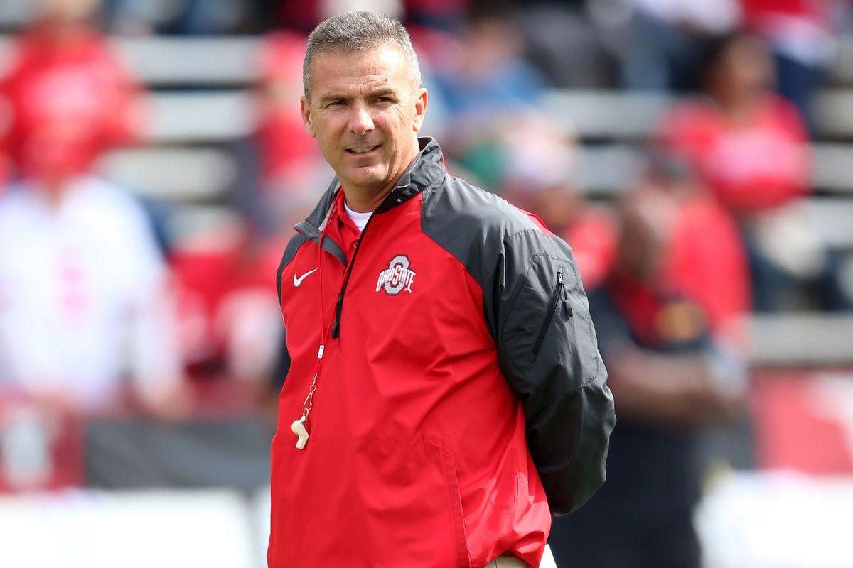 Ohio State head coach Urban Meyer looks on.