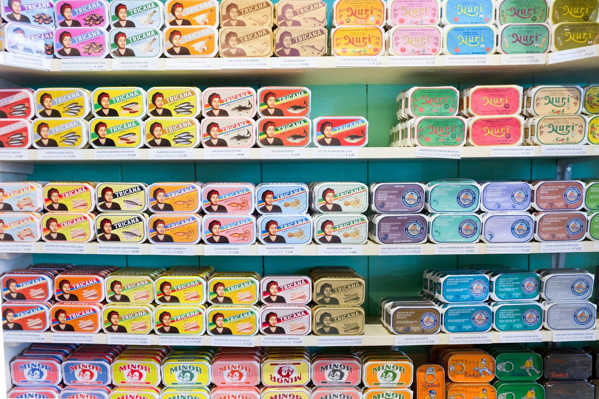 Rows of colourful tins of conservas, Portuguese tinned fish, in Lisbon